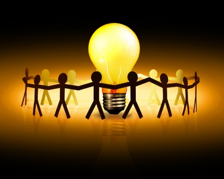 people joining hands around a lightbulb, representing concept of peer to peer lending