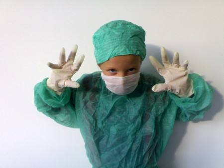 child dressed up as a surgeon