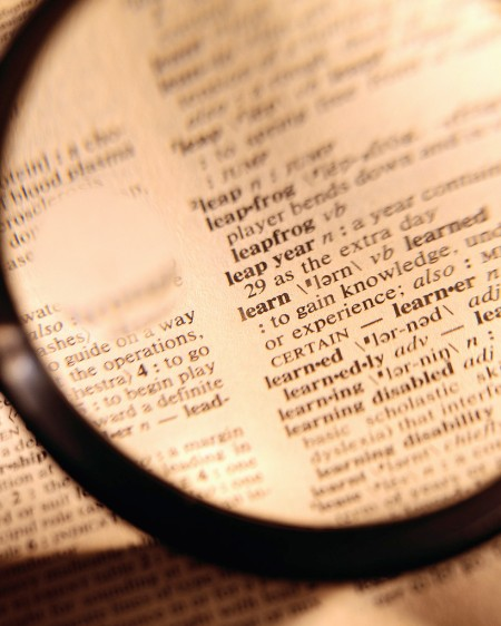 dictionary and a magnifying glass