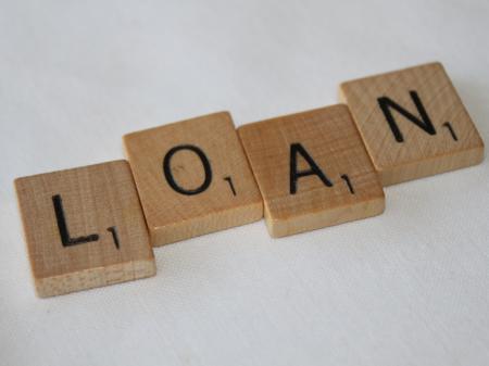 scrabble tiles spelling 'loan'