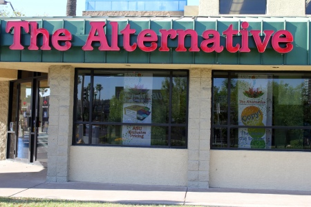 "a bank renamed with a sign reading ""The Alternative"""